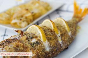 Besugo al horno con patatas al vino y limón